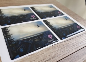 white foil + doming gel, printed CMYK Size: 78 x 63.5 mm