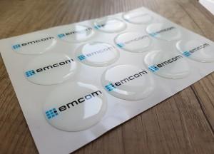 White foil + doming gel, printed CMYK. Size: Ø 4 cm