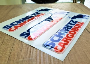 White foil + doming gel, printed CMYK, cut to shape. Size: 200 x 60 mm