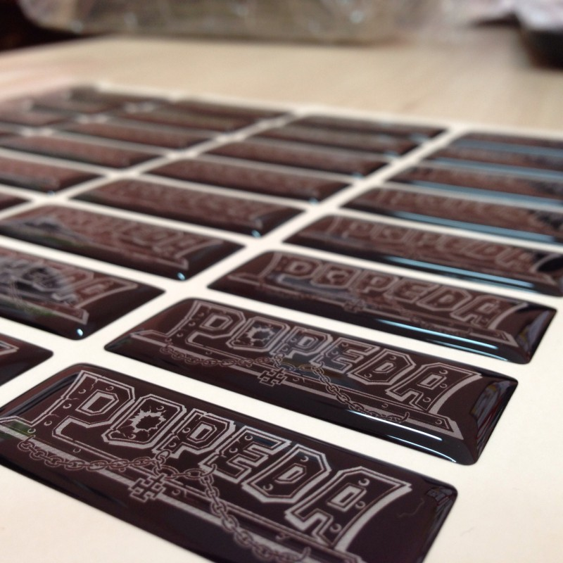 white foil + doming gel, printed CMYK or PMS, cut to shape