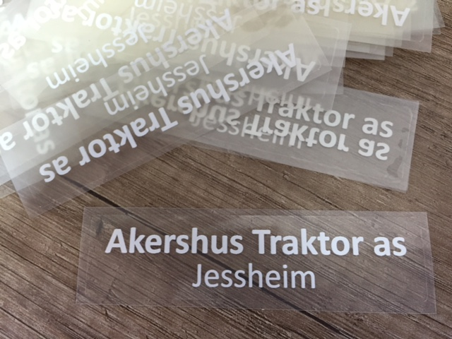 Clear view transparent foil direct UV printed with two strikes white, cut to size 10 x 2.5 cm.