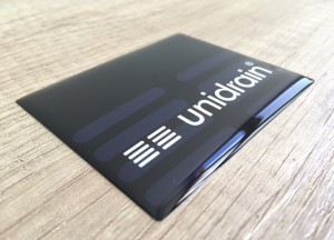 white foil + doming gel, printed CMYK or PMS with cut to shape rectangle with round corners (1.5-2 mm). Size: 7.8 x 6.35 cm
