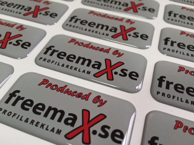 white foil + doming gel, printed CMYK or PMS, cut to rectangle shape. Size: 50 x 25 mm
