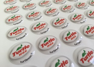white foil + doming gel, printed CMYK or PMS with cut to shape circle Size: 17.8 mm diameter
