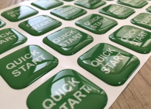 white foil + doming gel, printed CMYK or PMS with cut to shape circle Size: 28 x 28 mm