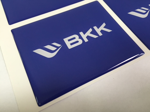 white foil + doming gel, printed CMYK with cut to rectangular shape Size: 78 x 63.5 mm
