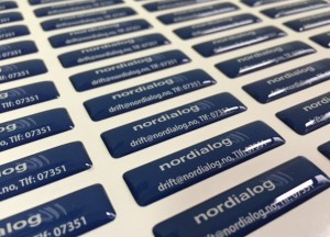 white foil + doming gel, printed CMYK or PMS with cut to rectangular shape