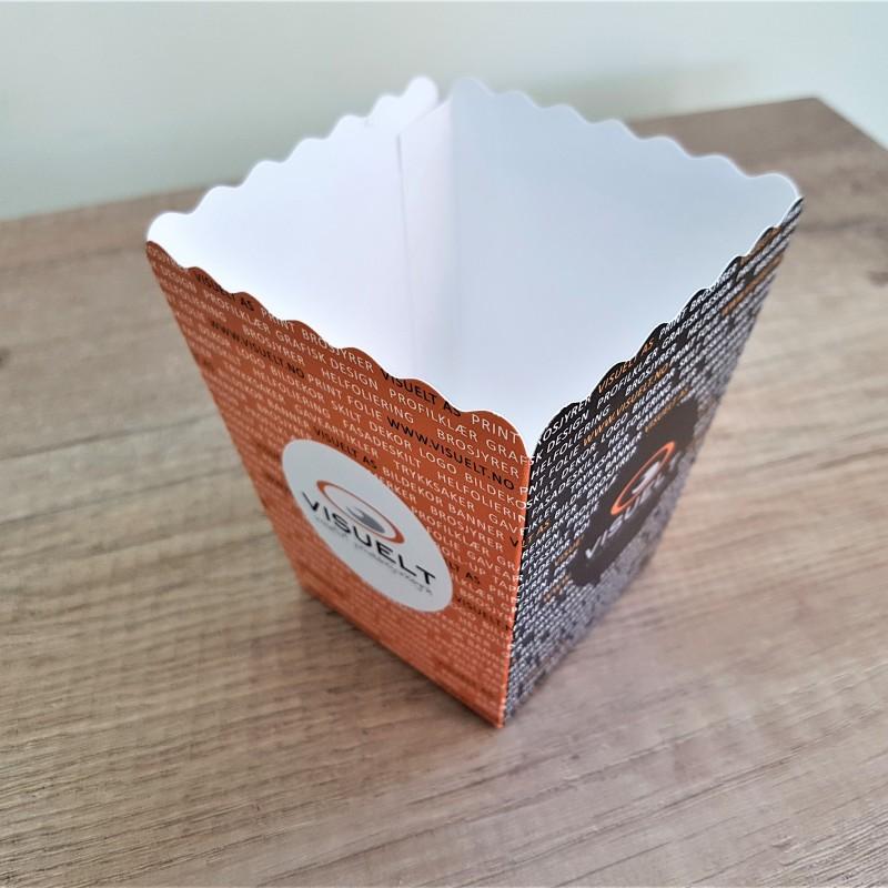 250 gsm cardboard, 4 + 0 offset printed, die cut to shape. Size: 9 x 6 x 8 cm