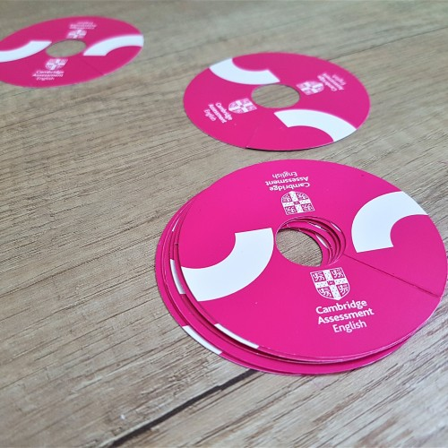 250 gsm glossy paper, printed 4 + 0 CMYK, cut to circle shape Size: Ø 75 mm