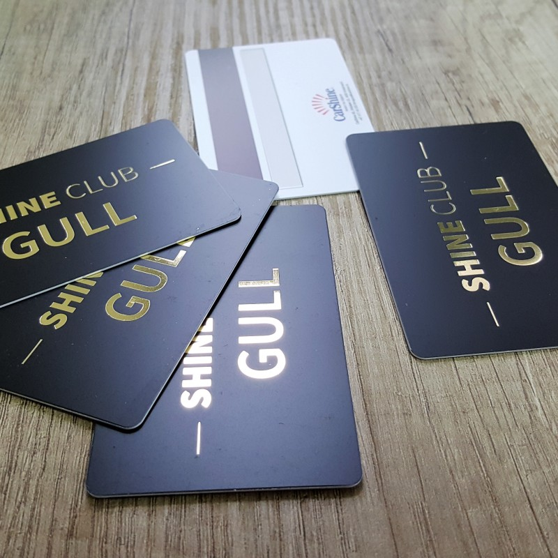 0.76 mm solid PVC, printed CMYK + hot stamp /gold/, magnetic stripe LoCo, signature field, glossy black thermal personalization. Size: 85.6 x 54 mm .