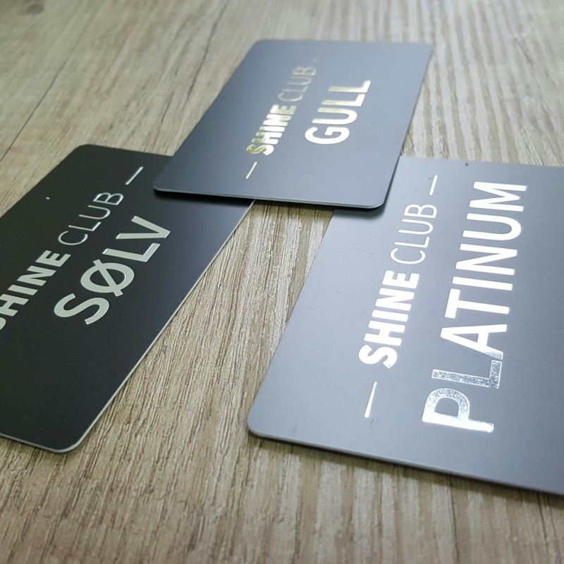 0.76 mm solid PVC, printed CMYK + hot stamp /silver, gold, platinum/, magnetic stripe LoCo, signature field, glossy black thermal personalization. Size: 85.6 x 54 mm