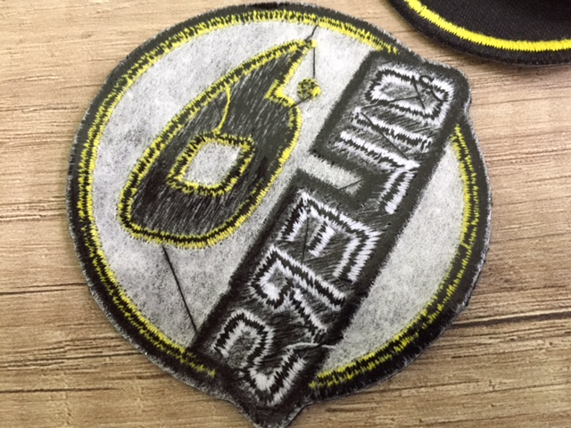 diameter7 cm, 3-dimensional embroidering with heat glue on the back