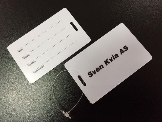 0.7 mm PVC card, CMYK printed with glossy lamination and space for writing on the back side, in size 5.6x8.6 cm, with hole 14x3 mm