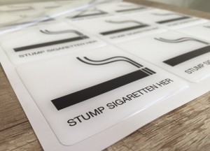 white foil + doming gel, printed CMYK or PMS with cut to shape rectangle with round corners (1.5-2 mm). Size: 7.5 x 7.5 cm