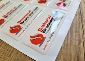 White PVC foil + doming gel, printed CMYK Size: 75 x 30 mm
