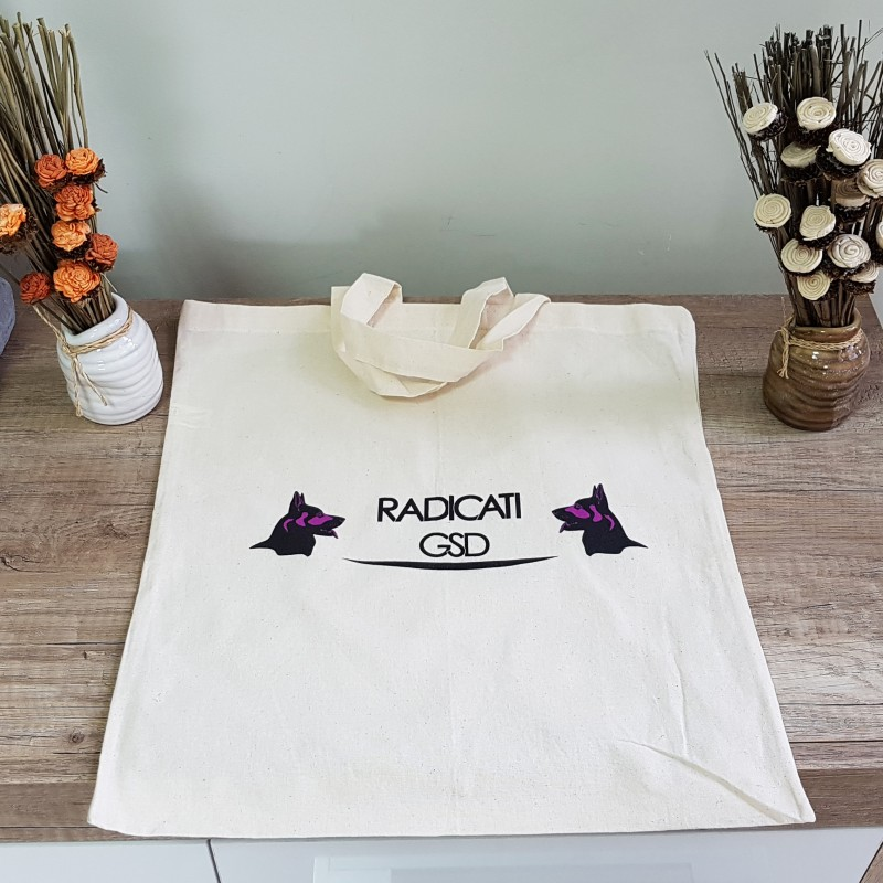 105 gsm natural environmental friendly cotton, printed 2 colors  one side, long handles. Size: 38 x 42 cm