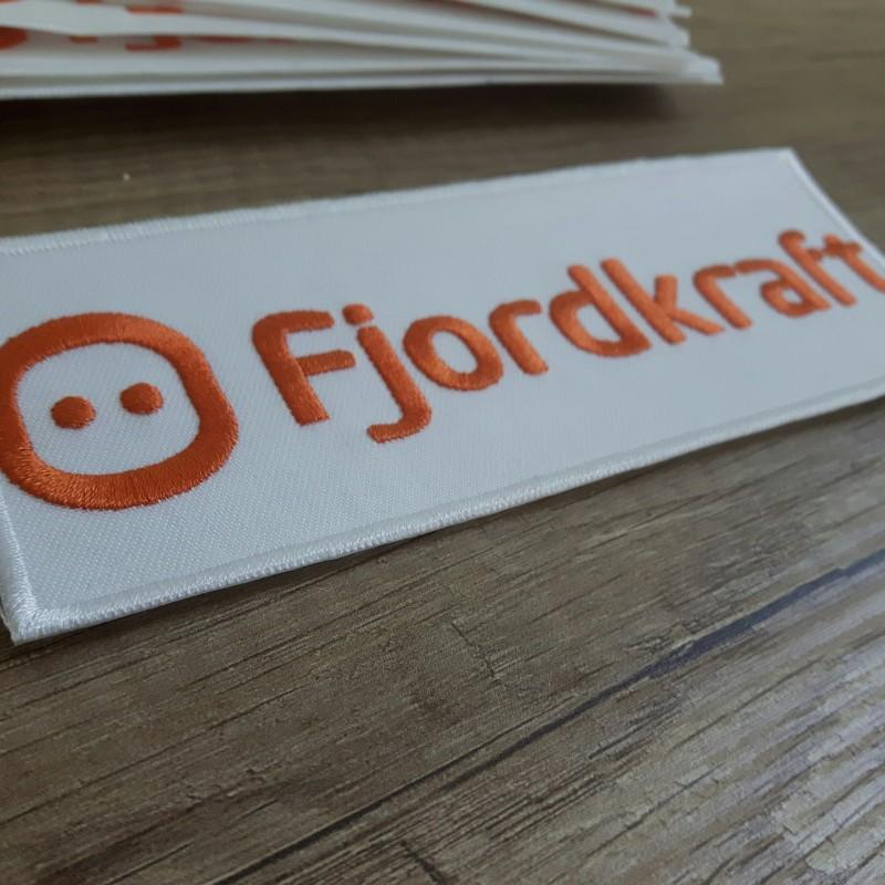 Fjordkraft embroidered logo