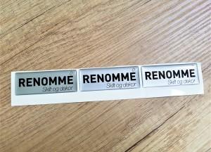 Silver PVC foil + doming gel, printed CMYK. Size: 61 x 23 mm