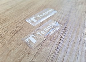 Transparent PVC foil, silk-screen printed 1 color /white/ Size: 40 x 15 mm