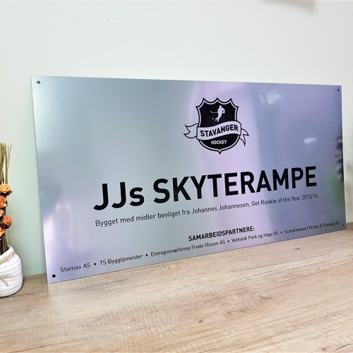 1.6 mm micro-surfaced impact  acrylic with stainless steel finish, black engraved logo, Ø6 mm holes in each corner. Size: 40 x 80 cm