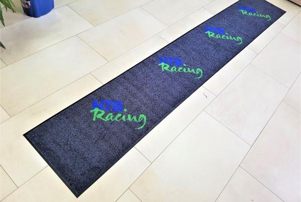 100% High Twist Nylon, Polyamid 6.6, backing - 100% Nitrile rubber, blue and green logo on black background. Size: 0.5 x 3.2 m