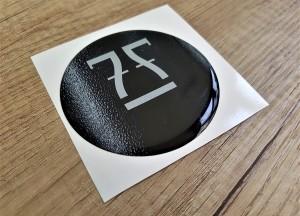 Reflective PVC foil + doming gel, printed CMYK 4 + 0 Size: Ø 80 mm