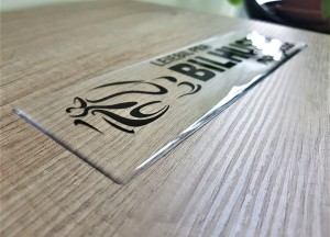 Transparent PVC foil + doming gel, printed CMYK Size: 25 x 7 cm