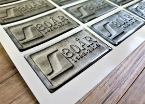 Chrome PVC foil + doming gel, printed CMYK. Size: 70 x 40 mm