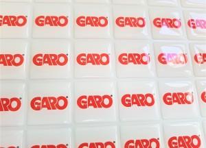 White PVC foil + doming gel, printed CMYK. Size 28 x 28 mm