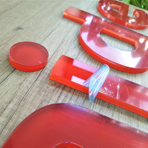 Acrylic letters. 10 mm transparent acryl. Colored foil on the back and self-adhesive tape.