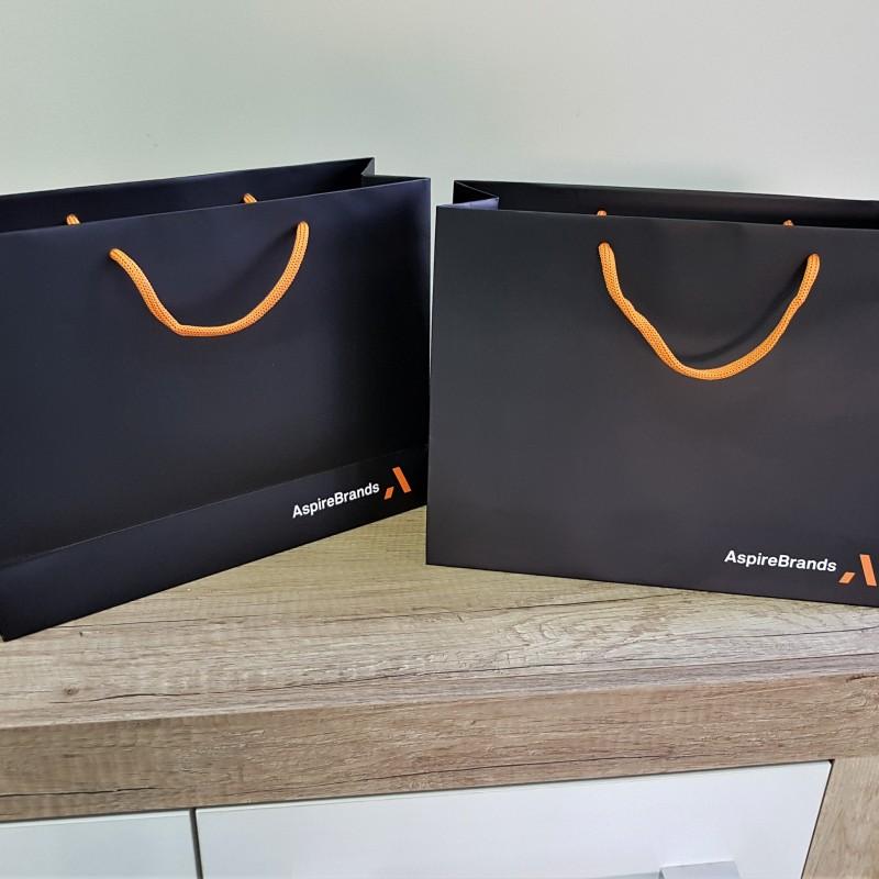 Size: 35 x 25 x 12 cm, 200 gsm matt paper, print: 4+0 matt laminate,  reinforced bottom and handles area, orange polyester textile handles