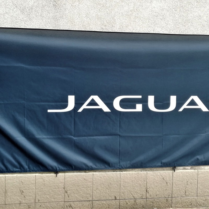125 gsm polyester textile, SUB printed, sewed hems, reinforced left side with 4 carabiner hooks. Size: 100 x 300 cm