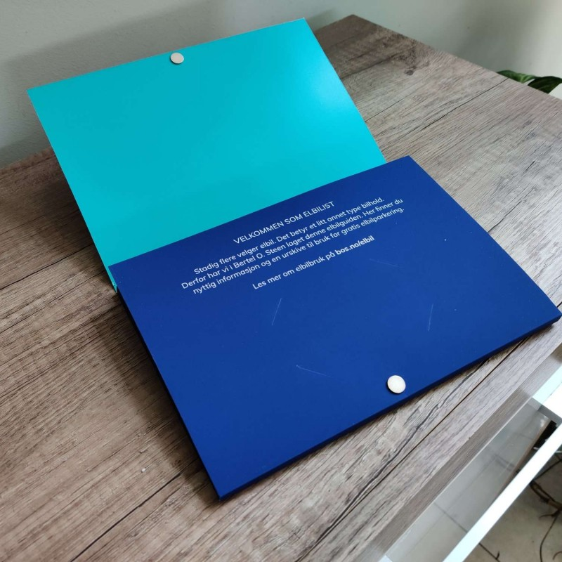 490 x 400 mm unfolded 350 gsm paper + lamination 4+4 CMYK print Die cutting, folding, magnet/2 pcs. 10mm DIA and 1mm d, adding key holder /given by customer/ and brochure Face - one sided soft touch laminate + partially UV varnish, Back - overprint varnish