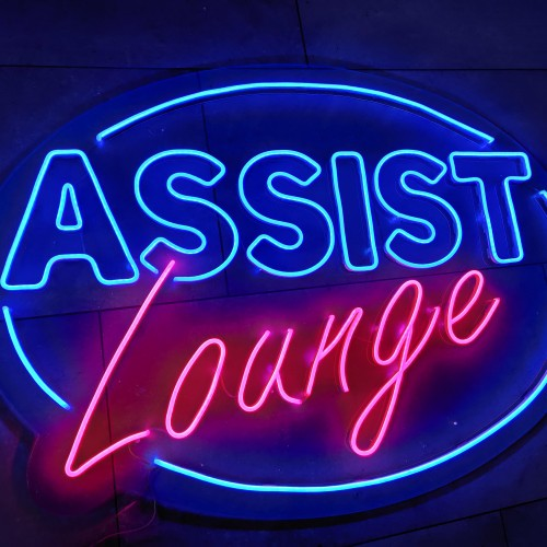 Assist Neon sign