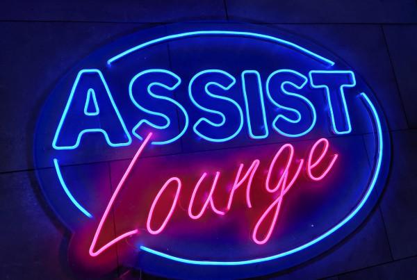 Assist Neon sign