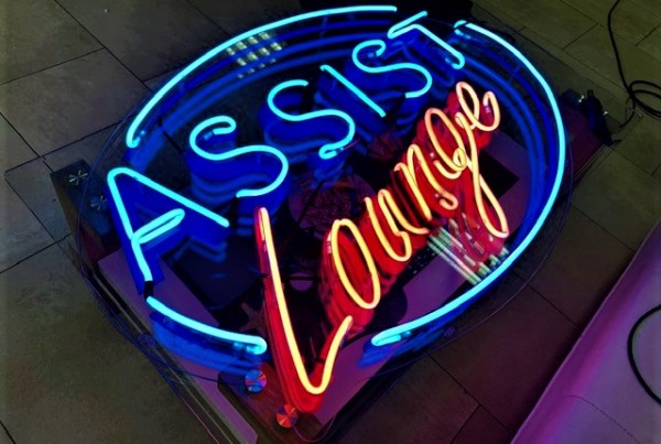 ASIST Lounge neon sign